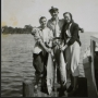 An old black-and-white photo of three people posing with large fish. The photo can be found at the Orange Beach Indian and Sea Museum.