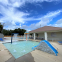 Children's Wading Pool with Spray Features and Slide at Orange Beach Aquatics Center