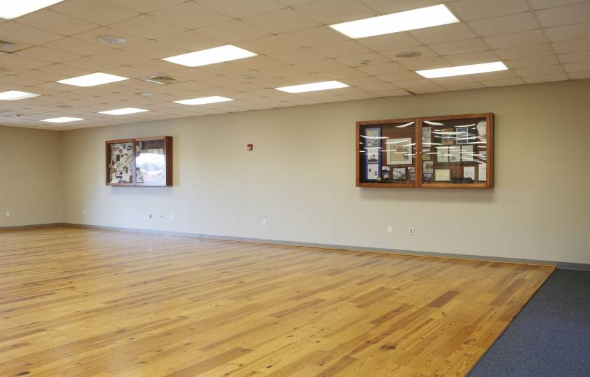 Orange Beach Community Center inside main room showing hardwood flooring area on the west side