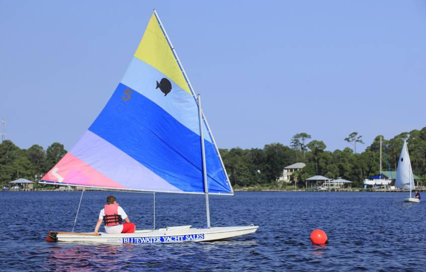 Sunfish Sailboat Race Heeling during Sail Camp at City of Orange Beach Wind & Water Learning Center