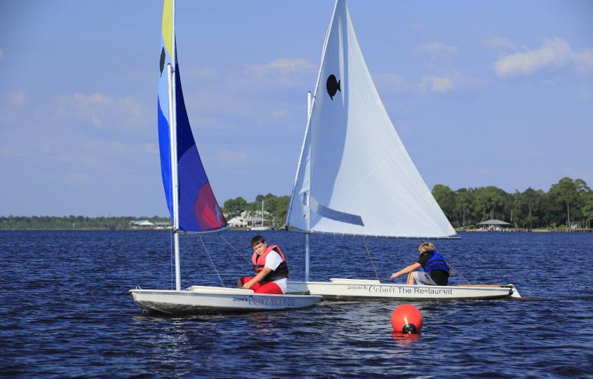Sunfish Sailboat Racing Heeling during Sail Camp at City of Orange Beach Wind & Water Learning Center