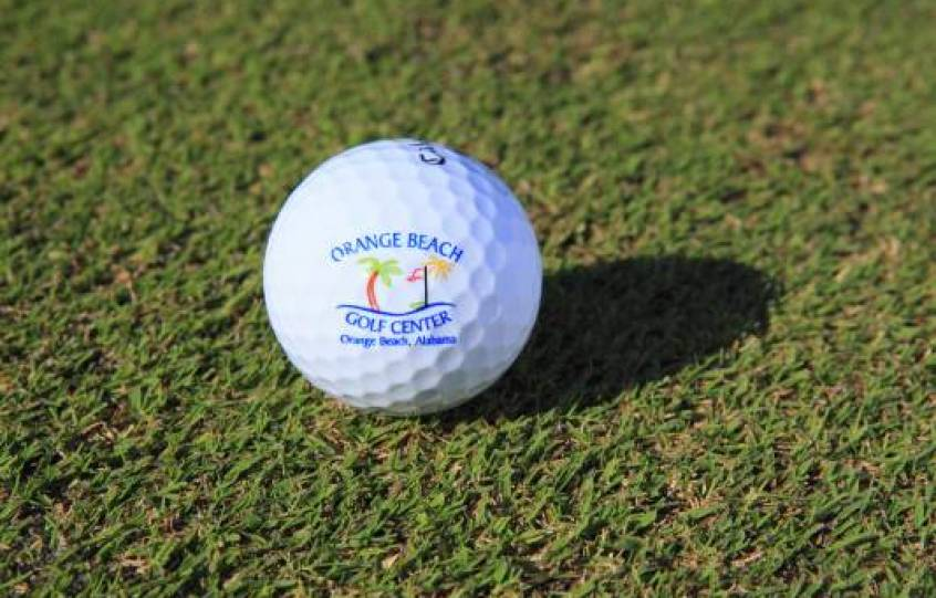 Golf ball with logo of Orange Beach Golf Center on it