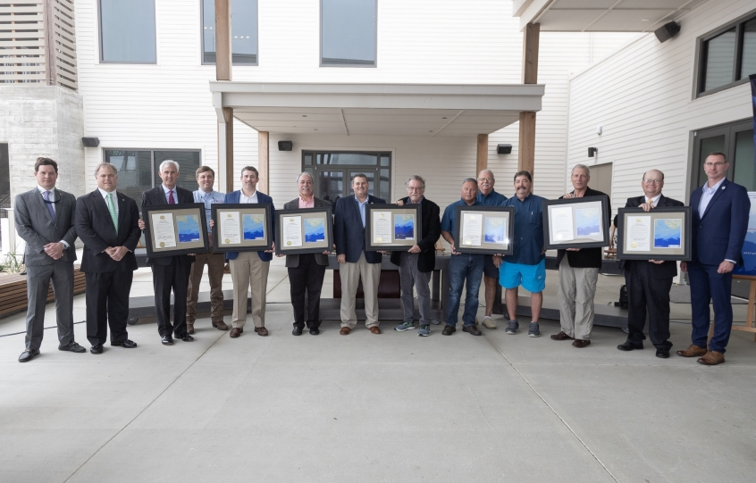 Conservation Commissioner Chris Blankenship (center) and honorees at a naming ceremony for eight new artificial reef zones in waters off the coast of Alabama. The ceremony took place at the Dunes Terrace at the Gulf State Park Lodge in Gulf Shores, Ala. -- Photo by Billy Pope, ADCNR