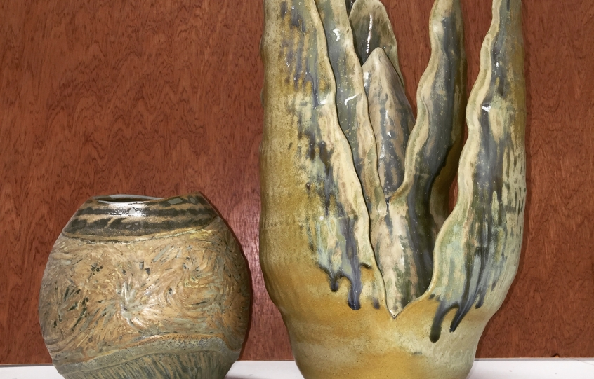 Display of three pottery pieces made at Clay Studio at Coastal Arts Center of Orange Beach