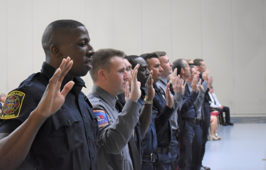13 members of the Firefighter I-II Recruit School Class 19-01 recite the Firefighter Oath