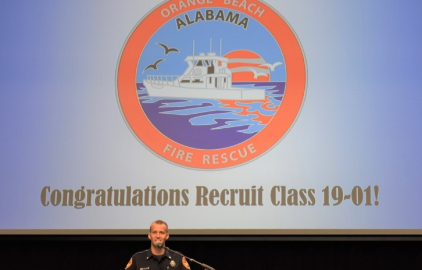 Foley firefighter Carter Chmielewski speaks at the podium at the Firefighter I/II Recruit School Class 19-01 graduation