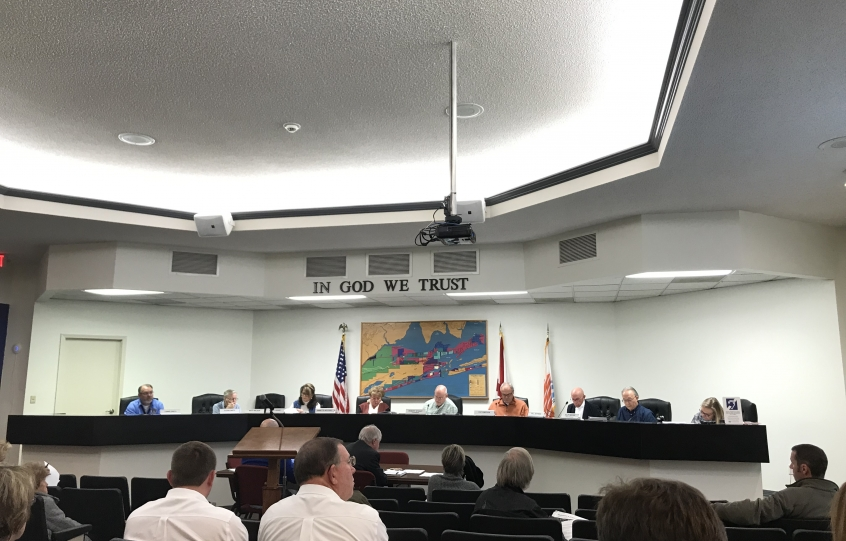 Orange Beach Planning Commission members seated behind the dais in the Council Chambers during a meeting in January 2019