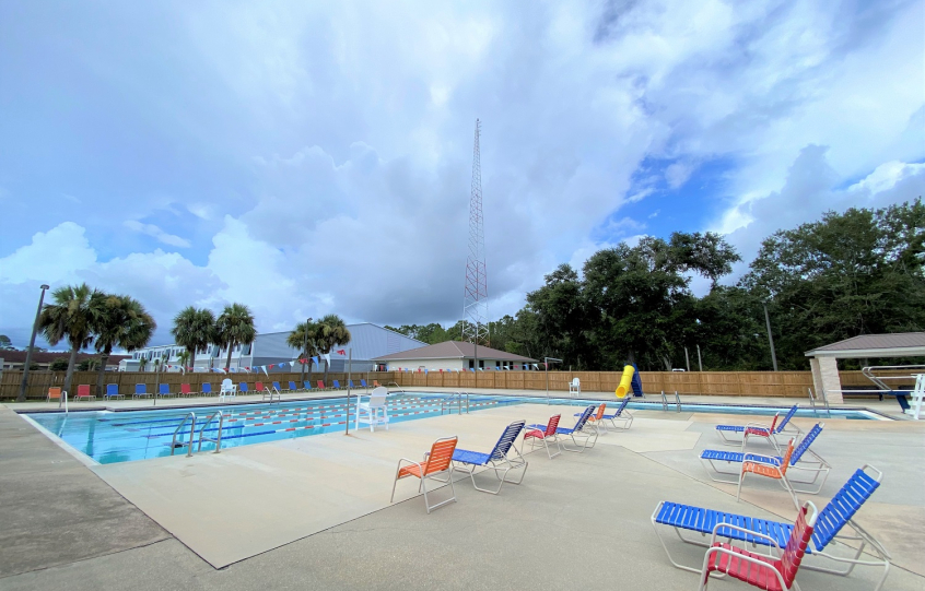 Loungers and chairs surround the pool at the Orange Beach Aquatics Center