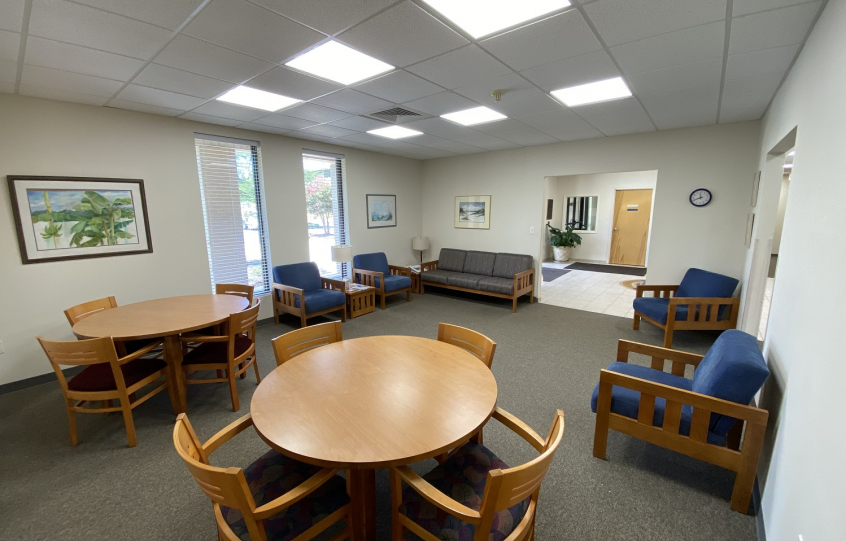 Photo of Orange Beach Senior Center sitting area with tables and chairs