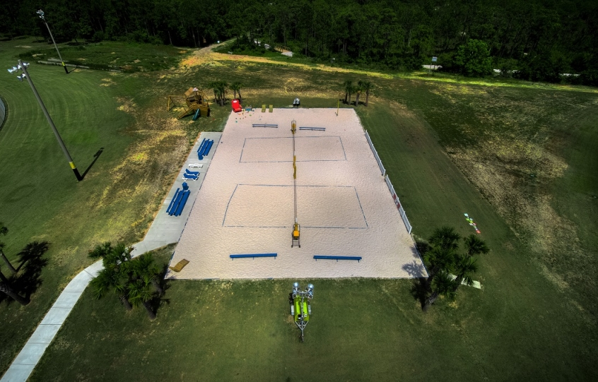 City of Orange Beach Sportsplex aerial showing the 2 sand volleyball courts and wooden pirate ship play area