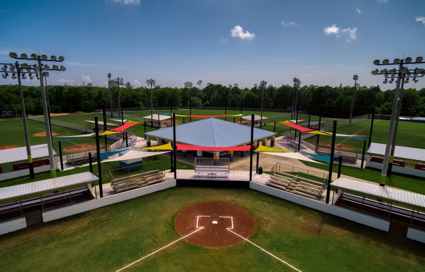 City of Orange Beach Sportsplex aerial closeup of Fields 1-5 for baseball and softball showing off upgrades of shades for spectators and new dugouts and backstop netting