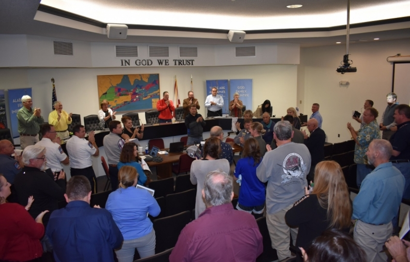 U.S. Navy Training Air Wing squadron recognized by Orange Beach City Council for football game flyover