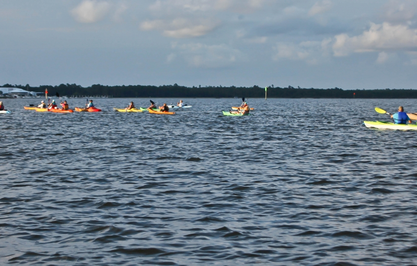 Kayakers paddle on Wolf Bay on June 16, 2019 as part of the Full Moon Paddle fundraiser benefiting City of Orange Beach Relay for Life team
