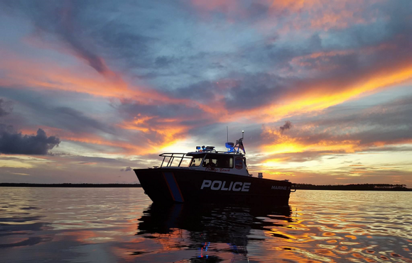 Orange Beach Police Department Marine Division boat on Wolf Bay at sunset