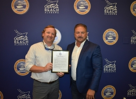City Plans Examiner Adam Roberson recognized by Orange Beach council for earning status of Master Code Professional