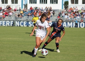 An Alabama women's soccer play dribbles the ball against an Auburn defender during the 2019 SEC Championship on Nov. 3, 2019 in Orange Beach, Alabama