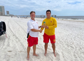 Beach Safety Division Chief Brett Lesinger and Lifeguard of the Year Jean Tinoco