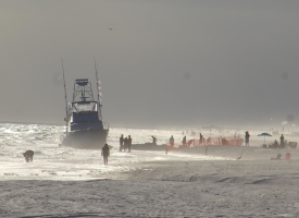 Beached vessel on state shoreline in Orange Beach