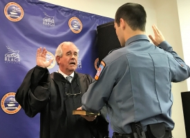 Orange Beach Municipal Judge Buddy Brackin swears in Officer JP Burnside