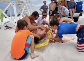 Photo of Orange Beach Fire Department's Surf Rescue personnel conducting a Junior Lifeguard training session in Summer of 2018