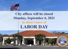 Labor Day 2021 closings graphic that include a photo of Orange Beach City Hill with the American flag and wording overlaid announcing the closure