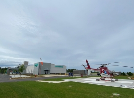 New Freestanding Emergency Department opens Saturday in Gulf Shores - South Baldwin Regional Medical Center expands services - photo of building in background with LifeFlight on the helipad in the foreground.