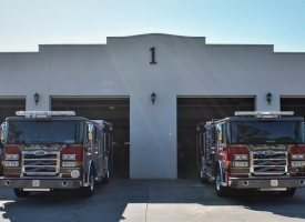 Two new fire engines sit parked in front of Orange Beach Fire Station No. 1