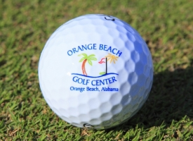 Golf ball with Orange Beach Golf Center logo on it