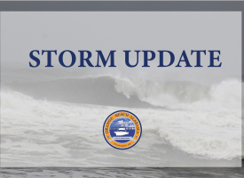 Generic Storm Update graphic with the words Storm Update overset on a photo of a large wave and the city's official seal at the bottom.