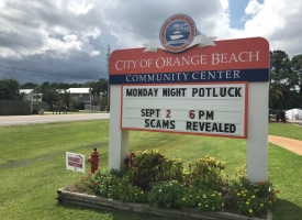 Community Potluck sign at Orange Beach Community Center